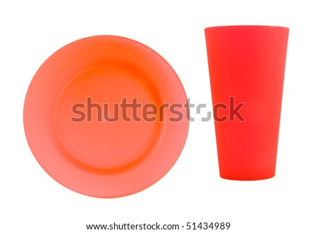 pink reusable plastic plate with hot pink cup on a white background