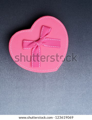 Pink ribbon on pink heart