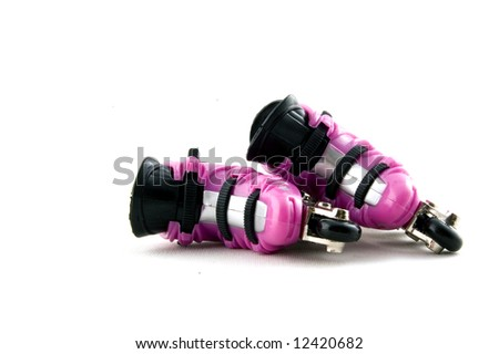 pink rollerblades laying down isolated on a white background