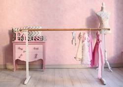 pink room with dresser and classical ballet stand with dress