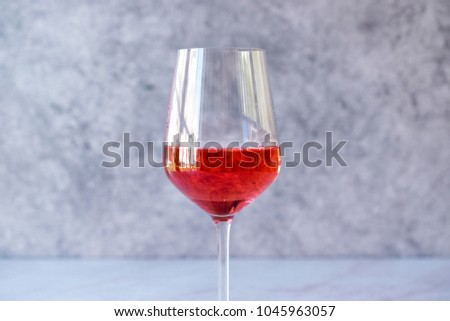Pink Rose Blush Wine in Glass #1045963057