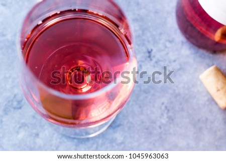 Pink Rose Blush Wine in Glass #1045963063