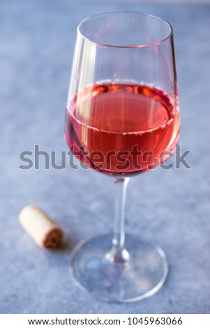 Pink Rose Blush Wine in Glass #1045963066