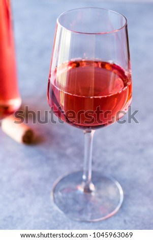 Pink Rose Blush Wine in Glass #1045963069