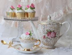 Pink Rose Cupcakes in a vintage tea cup, cake stand and teapot - high tea party