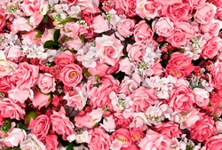 Pink rose flowers bouquet background for Valentine's Day decoration, top view.