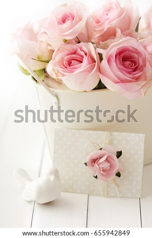 pink rose flowers in a vase and love letter, gift tag, greeting card or wedding invitation