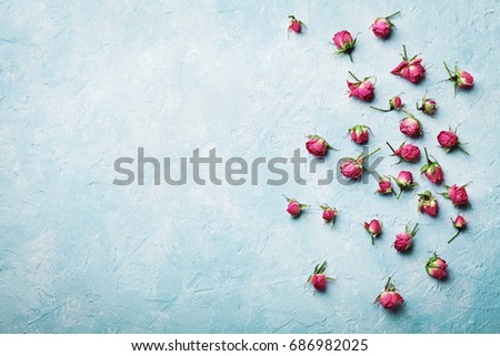 Pink rose flowers on blue vintage table top view in flat lay style.  #686982025
