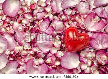 Pink rose petals background with red heart