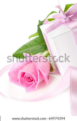 Pink rose with gift-box on white background