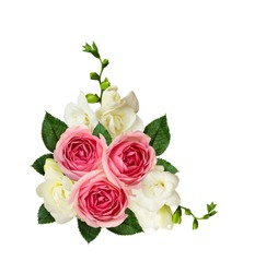 Pink roses and freesia flowers in a corner arrangement isolated on white background. Top view. Flat lay.