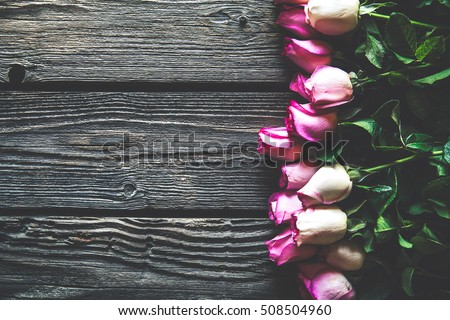 Pink roses bouquet over wooden table. Top view with copy space. flowers #508504960