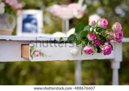 Pink roses in the drawer of an old Desk #488676607