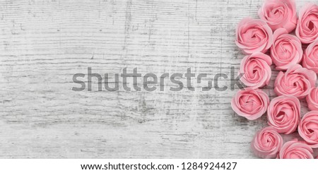 Pink roses on the wooden background #1284924427