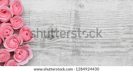Pink roses on the wooden background #1284924430