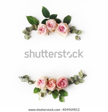 Pink roses on white background. Flat lay. Frame wreath