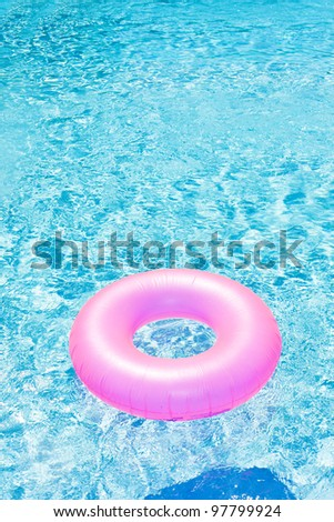 pink rubber ring in swimming pool