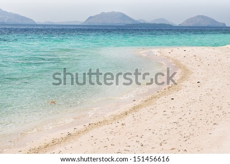 Pink sand and turquoise water of Flores Sea