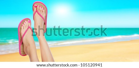 Pink sandals on woman legs. Summer time concept