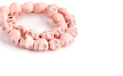 Pink semiprecious stone beads isolated on white background - close up