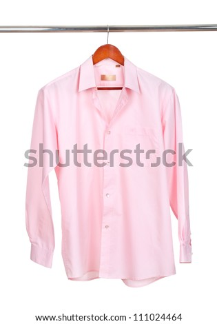 pink shirt on wooden hanger isolated on white
