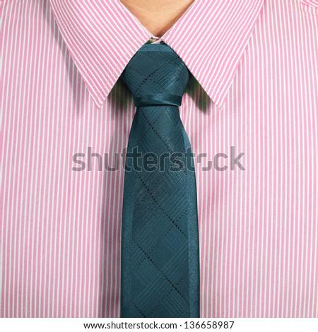 pink shirt with dark blue necktie