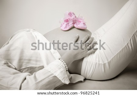 Pink shoes on mummy stomach