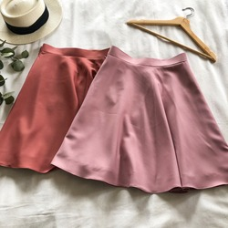 Pink skirt lay in bed lady clothing handmade clothes women fashion photo two skirts in girls dressing room summer retro fashion tailor made