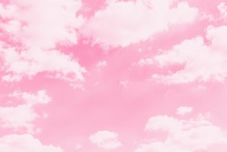 Pink sky background with soft delicate white clouds. Copy space