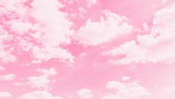 Pink sky background with soft delicate white clouds. Copy space. Romantic 16 on 9 panoramic background