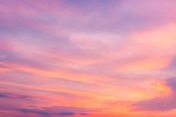 Pink sky,Dusk clouds in the evening,idyllic purple peaceful nature sunlight orange sunset landscape background.