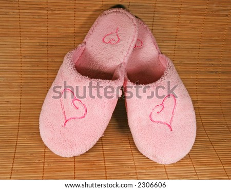Pink slippers with a heart sign