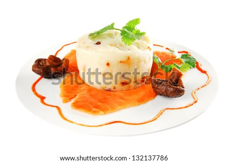 pink smoked salmon with mashed potatoes served on white