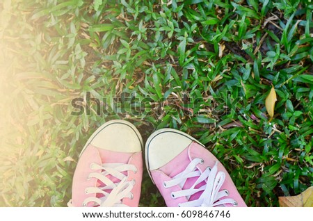 Pink sneakers put on grass  #609846746