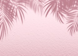 Pink soft cement texture wall leaf plant shadow background. Summer tropical travel beach with minimal concept. Flat lay pastel color palm nature.