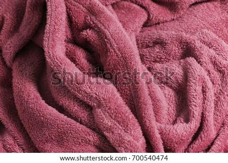 Pink soft fabric shaped as female genital organ, vagina