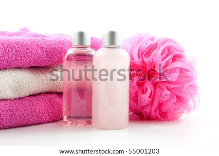 pink spa bathroom accessory on cane mat over white background