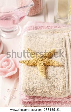 Pink spa set: liquid soap, essential oils, towels and sea salts