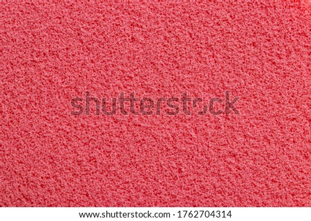 Pink sponge texture. Close-up of a beautiful fleecy pink cosmetic sponge for background. Macro photograph. Foto stock ©