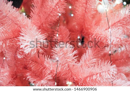 Pink spruce branches. Christmas tree decorations and decorations in the design.