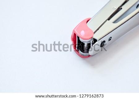 Pink stapler on white background - image
