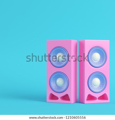 Pink stereo speakers on bright blue background in pastel colors. Minimalism concept. 3d render