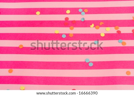 pink striped background with confetti great for parties