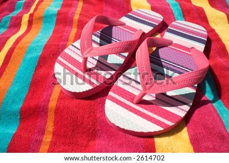 pink stripy flip flops - stock photo