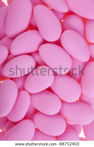 pink sugar covered almonds surface top view - stock photo