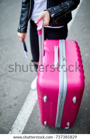 pink suitcase close up with...