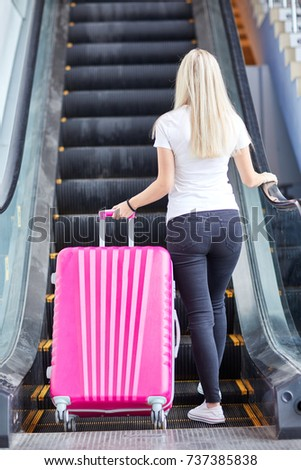 pink suitcase with a young girl ...