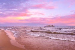 Pink sunset on lake beach sea sand beautiful colors in the sky clouds with island in the distance, Lake Malawi, Malawi, Africa