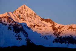 Pink Sunset on Snowy Wilson Peak.  The San Juan Range, Rocky Mountains, Colorado.