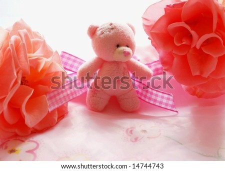 stock-photo-pink-teddy-bear-and-roses-14744743.jpg